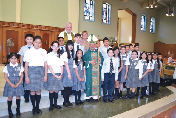 Cardinal Orlando Quevedo from the Philippines was joined by Father John Vesey, pastor of St. Michael's parish, Flushing, and children from Most Holy Redeemer Catholic Academy with their principal Maureen Rogone when he celebrated Mass at St. Michael's Church.