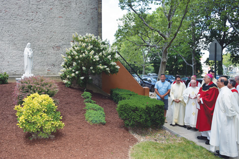 Bishop DiMarzio, along with other clergy and diocesan workers, admire the statue of Mary that was blessed in front of the Chancery building. (Photo © Maria-Pia Negro Chin)