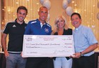 Msgr. Jamie Gigantiello and honored guest Judge Patricia DiMango, who appears on the TV court show Hot Bench, present a check for $100,000 from the CYO Golf Outing to CYO director Rob Caldera and Carlos Rafael Moerson, representing New York City Football Club. (Photo © Rita Damato)