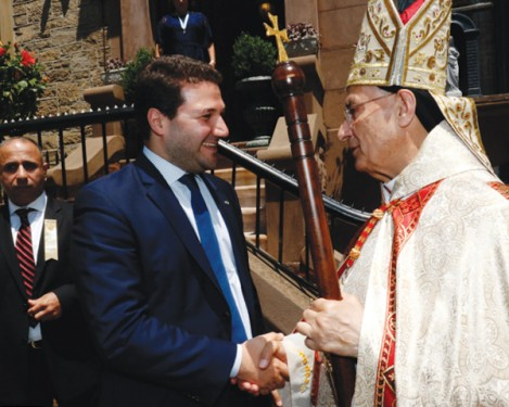Nadim Gemayel, a member of the Lebanese Parliament, greets Lebanese Cardinal Bechara Rai, patriarch of the Maronite Catholic Church, following a Divine Liturgy June 26 at Our Lady of Lebanon Maronite Cathedral, Brooklyn Heights. Gemayel is son of Bachir Gemayel, president-elect of Lebanon who was assassinated in 1982. (Photos: Gregory A. Shemitz)