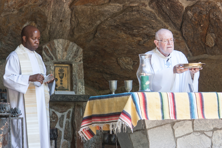 Father Pierre-Louis concelebrates the Mass with Father William Considine, S.M.M., of the shrine at left.