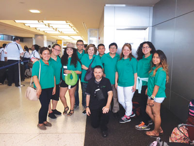 World Youth Day contingents from St. Brigid's parish, Bushwick, above, and St. Sebastian's, Woodside, wait out a rain delay at Kennedy Airport before embarking on flight to Poland.