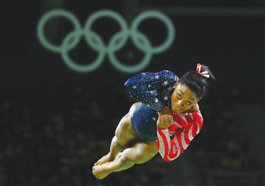 U.S. gymnast Simone Biles, a Catholic, competes on the floor exercise during the Summer Olympics in Rio de Janeiro Aug. 7. (Photos © Catholic News Service/ Mike Blake, Reuters)