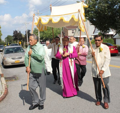 Archbishop Bernardino Auza, permanent observer of the Holy See to the U.N., carried a relic of 14th-century St. Rocco through the city streets.