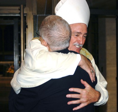 Bishop Tiedemann hugs Msgr. Fernando Ferrarese (Photo: Marie Elena Giossi)