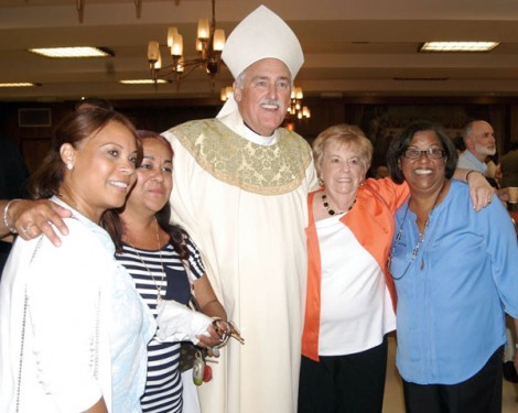 Bisop Tiedemann welcomes Visitation B.V.M. parishioners Sylvia Dobles, Ruthie Pitre, Elsie Tweedy and Milagros Almonte (Photo: Marie Elena Giossi)