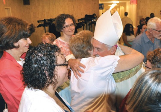 Bishop Tiedemann gets reacquainted with Annette Amendola and other parishioners from Visitation B.V.M., Red Hook, where he was pastor. (Photo: Ed Wilkinson)