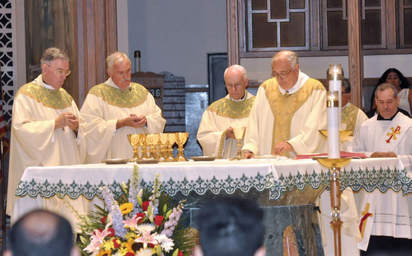 Brooklyn's new auxiliary bishop, Neil E. Tiedemann, C.P., second from left, concelebrates Mass Aug. 4 welcoming him back to the diocese at the Immaculate Conception Pastoral Center, Douglaston. From left, New York Auxiliary Bishop Gerald Walsh; Bishop Tiedemann; Auxiliary Bishop Raymond Chappetto, vicar general; and Bishop Nicholas DiMarzio. (Photo: Ed Wilkinson)
