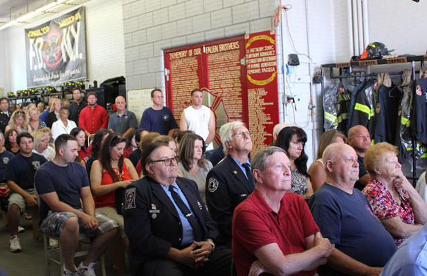 Firefighters and families attend Sept. 11 memorial Mass at the firehouse on Lorraine St. in Red Hook.