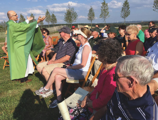 p Msgr. Roger A. Statnick pastor of St. Sebastian parish, Belle Vernon, Pa., in the Diocese of Greensburg, delivers the homily at a Mass of remembrance Sept. 10 at the Flight 93 National Memorial near Shanksville. (Photo: Catholic News Service/ Mary Seamans, The Catholic Accent)