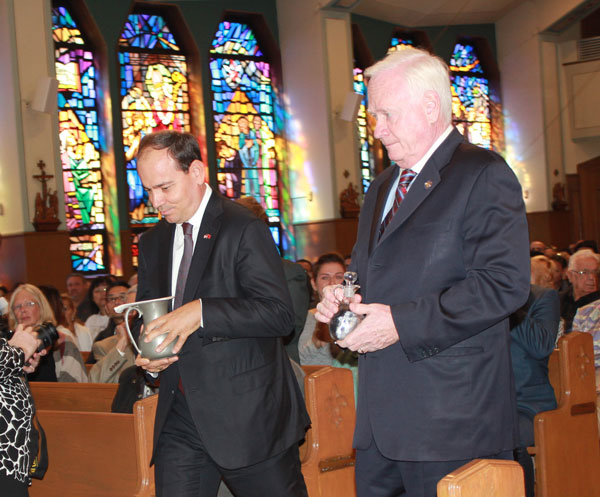 Bujar Nishani, the president of Albania, and State Senator Martin Golden were the gift bearers at a Mass at St. Athanasius Church that preceded the blessing of the neighborhood's new outdoors statue of St. Teresa of Calcutta.