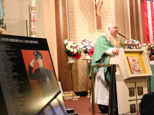 Msgr. Robert Romano, NYPD's deputy chief chaplain, celebrates a memorial Mass at Our Lady of Guadalupe Church, Dyker Heights, for the men and women in blue who died on Sept. 11, 2001.