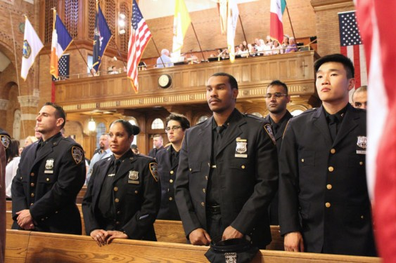 Members of the New York City Police Department attended a memorial Mass at Our Lady of Guadalupe Church, Dyker Heights, for the members of their department who died in the terrorist attacks of Sept. 11, 2001, as well as in the aftermath of that day of infamy. (Photos: Marie Elena Giossi)