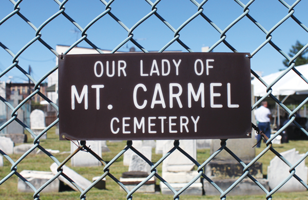 """Some of the gravesites at Our Lady of Mount Carmel """"Graveyard"""" can be read better than others. They tell the story of the first Catholic parishioners of the area and date back to 1841."""