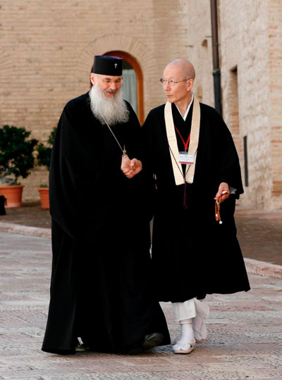 Religious leaders talk as they arrive for the Assisi gathering.
