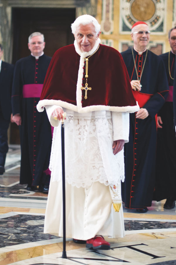 Pope Benedict XVI walks with his cane in 2013 at the Vatican following his final general audience. Retirement has given the 89-year-old Pope Benedict what he describes as the gift of silence to enter more deeply into prayer, especially with the Psalms and the writings of early Church theologians. (Photo: Catholic News Service photo/L'Osservatore Romano)
