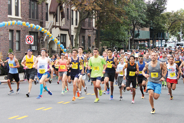 Runners take off along Shore Road in Bay Ridge the 28th annual P.O. Christopher Hoban Memorial Five-Mile Run hosted by Xaverian H.S. Photo © Jim Mancari