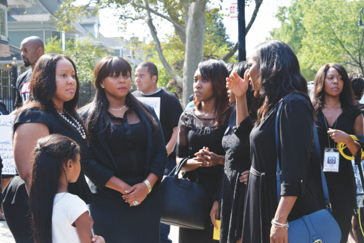 Mourners stand in front of Holy Innocents Church, Flatbush, after the funeral Mass for Anthony Nazaire, 19, a local young man who was in his second year of studies at the Business School of Ithaca College. Internment followed at Cypress Hills Cemetery. (Photo: Antonina Zielinska)