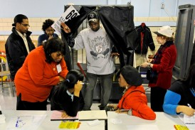 In this Nov. 4, 2008 file photo, James Waitemon exits a voting booth in New York City after voting in the presidential election. After 50 years, voting rights remain difficult question in many communities. (CNS photo/Peter Foley, EPA) See WASHINGTON-LETTER-VOTING Aug. 27, 2015.