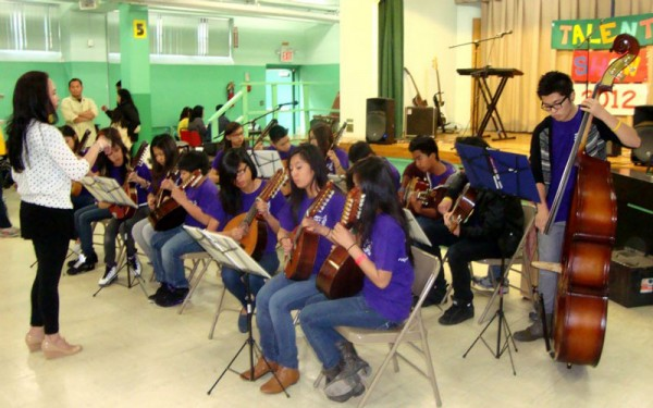 Samalca-Manligoy with the Filipino Arts and Music Ensemble. (Photo courtesy of Ruth Samalca-Manligoy)