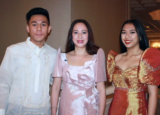 Ruth Samalca-Manligoy, center, selected as this year's Shining Star from the diocesan Filipino community, is pictured with her own shining stars, her son Margoux, left, and daughter, Francesca. (Photo: Marie Elena Giossi)