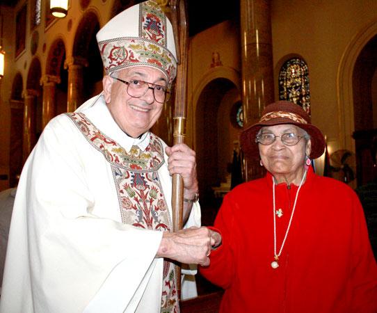 Vincilia Kirton, 102, assures Bishop Nicholas DiMarzio of her prayers.