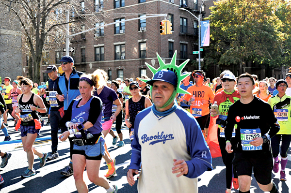 Participants in the New York City Marathon make their way along Brooklyn's Fourth Ave. near Our Lady of Angels Church in Bay Ridge.