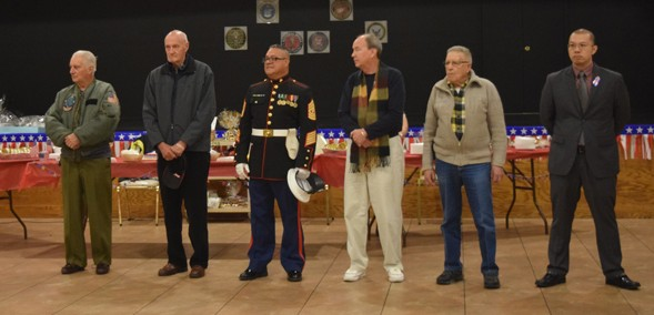 Veterans were honored with a special Mass and reception at SS. Simon and Jude, Gravesend, in honor of Veterans Day and the feast of the patron saint of soldiers, St. Martin of Tours. Above they were asked to come up and be recognized during the reception in the church basement.