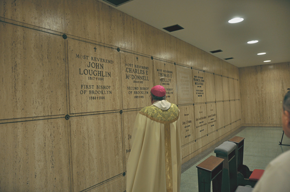 Bishop Nicholas DiMarzio blesses the new tombs of the first three bishops of Brooklyn in the crypt at Immaculate Conception Pastoral Center, Douglaston.