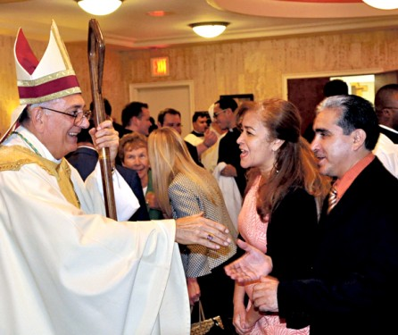 20 years a bishop the tablet deacon franklin munoz and his wife ana maria from incarnation parish queens village congratulate the bishop m4hsunfo