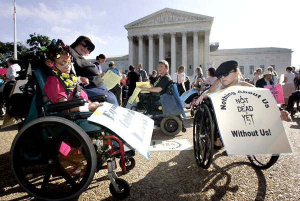 Disabled protesters against physician-assisted suicide gather in their wheelchairs outside the U.S. Supreme Court in Washington. (Photo: Catholic News Service/ Jason Reed, Reuters)