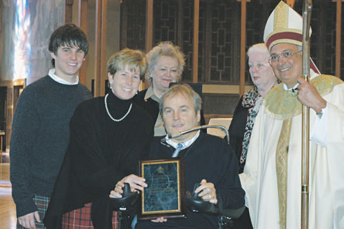 In 2006, Detective Steven McDonald was presented the Diocese of Brooklyn's Pro Vita Award by Bishop Nicholas DiMarzio. He is shown with his wife, Patti Ann and his son, Conor. (Photo: Marie Elena Giossi)