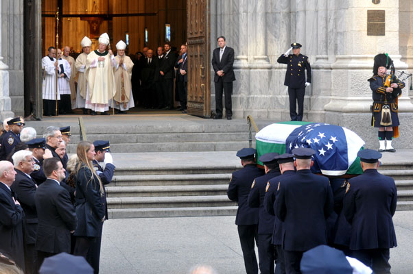 The coffin bearing the remains of Detective Steven McDonald is brought to St. Patrick's Cathedral where it was met by Cardinal Timothy Dolan, accompanied by Brooklyn Auxiliary Bishop James Massa and N.Y. Auxiliary Bishop John O'Hara. (Photo: Ed Wilkinson)