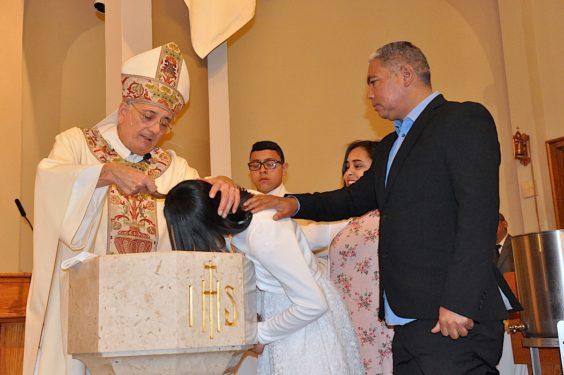 Bishop baptizes