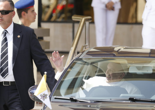 Pope Francis waves as he leaves the international airport in Cairo April 28. (CNS photo/Paul Haring)