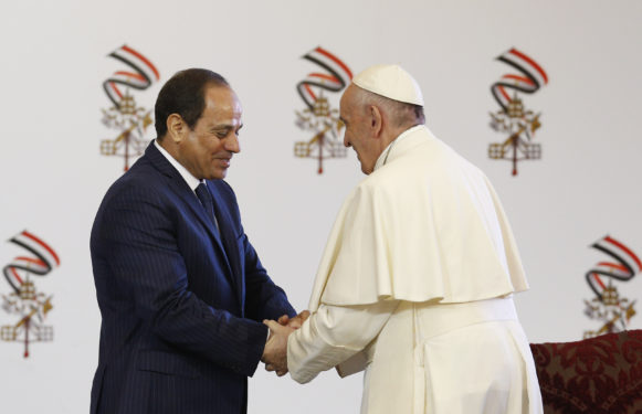 Pope Francis greets Egyptian President Abdel-Fattah el-Sissi and government officials during a meeting in Cairo April 28. (CNS photo/Paul Haring)