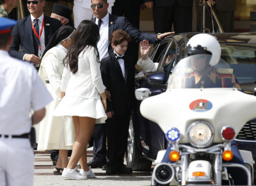 Pope Francis greets a nun and two youths who walked over to his car at the international airport. (CNS photo/Paul Haring)