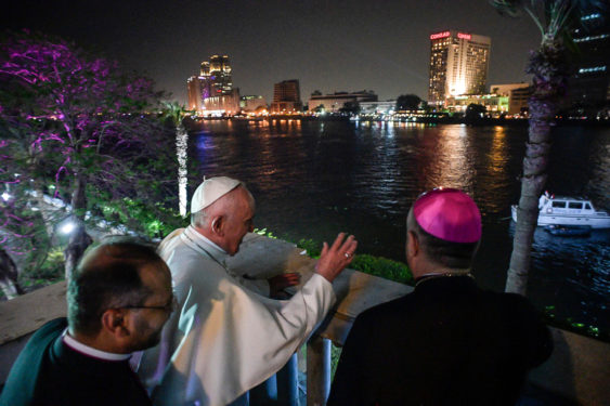 Pope Francis waves to people from the Apostolic Nunciature overlooking the Nile River in Cairo April 28. (CNS photo/L'Osservatore Romano, handout)