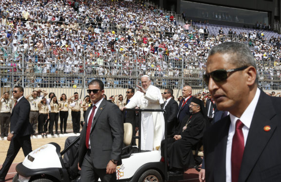 Pope Francis greets the crowd as he arrives to celebrate Mass at the Air Defense Stadium in Cairo April 29. (CNS photo/Paul Haring)