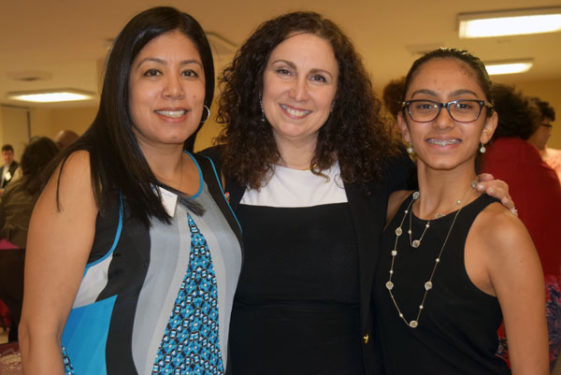 Radhika Sawh, left, and her daughter, right with NYBC representative