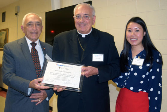 Joseph Sciame accepts on behalf of St. John's University