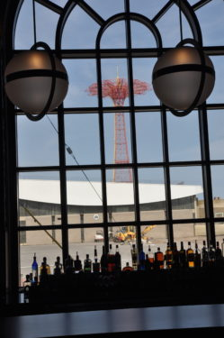 Coney Island's iconic Parachute Jump is seen through the windows of the Boardwalk's newest restaurant, Kitchen 21, part of the Ford Amphitheater complex.