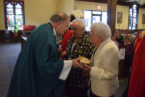Sisters of Msgr. Burke Patricia Fowler and Cecilia Kane, brought up the gifts.