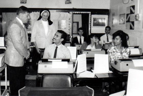 Sister Mary Franciscus, R.S.M., founder of Opportunities for Better Tomorrows, is seen in this undated photo with OBT trainees learning how to type on typewriters.