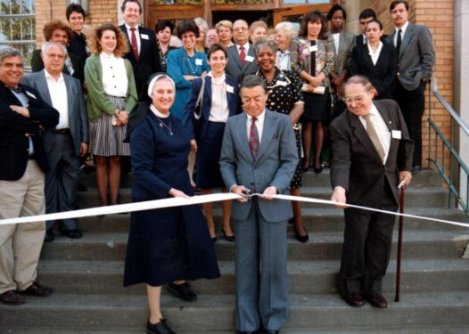 Sister Mary Franciscus, R.S.M., the founder of Opportunities for Better Tomorrows, helps then-Brooklyn Borough President Howard Golden cut the ribbon at the grand opening of OBT's Sunset Park location