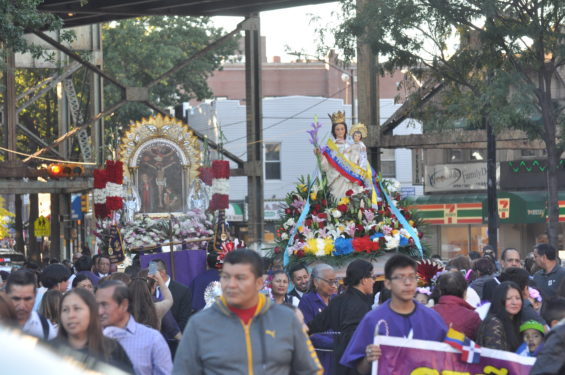 two statues in procesion