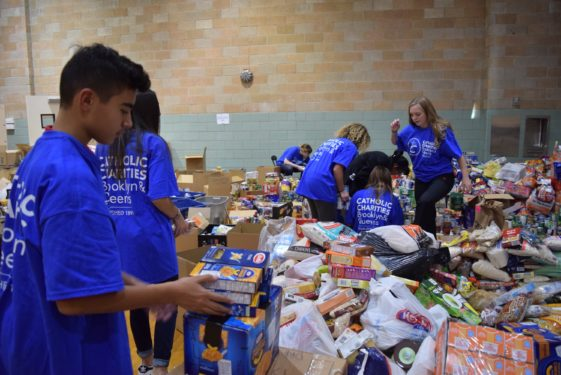 Student leaders from the Key Club at St. Francis Prep H.S., Fresh Meadows, loaded their donations onto a bus and headed to the diocesan drop-off site in Douglaston to help sort the collections from more than 60 parishes. More than 33,500 pounds of goods will be shipped to Caritas Puerto Rico.