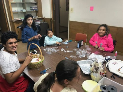Teens ready lollipops for Hurricane Maria disaster relief fundraiser.