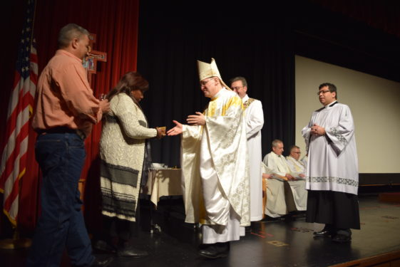 Bishop Massa celebrated Mass before people broke into smaller groups to attend workshops in both English and Spanish.