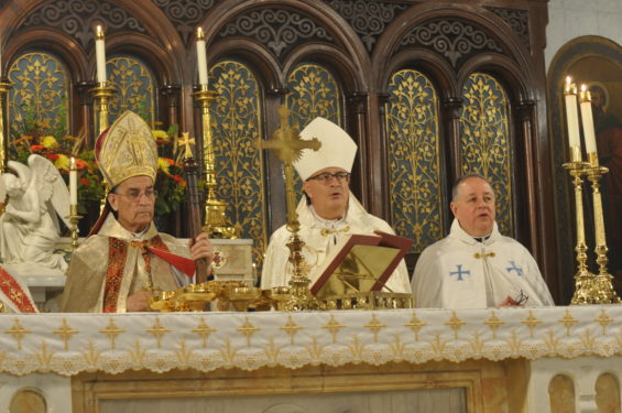 Lebanese Cardinal Bechara Rai is seen at the altar of Our Lady of Lebanon Cathedral, Brooklyn Heights, with Brooklyn Maronite Bishop Gregory Mansour, and Msgr. James Root, the cathedral's rector.